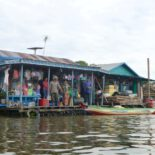 Floating store on Tonle Sap, Southeast Asia's largest freshwater lake, home to thousands of dispossessed people. The lake faces numerous threats, including a dam-building boom in China and Laos. Photo by Erica Gies.